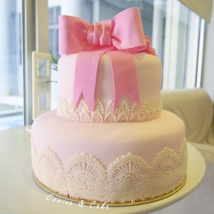 2 tiers pink ribbon and lace cake