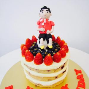 Man on soccer ball naked fruits cake